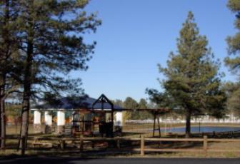 Covered picnic area next to the fishing pond and Playground equipment for family fun.  Tennis, basketball, and volleyball courts across from the playground area.
